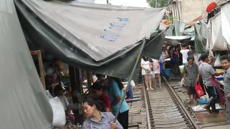 maeklong : Samut Songkhram, Thailand-October 16, 2016: Time lapse view of Mae Klong railway market from the Mae Klong line train cabin