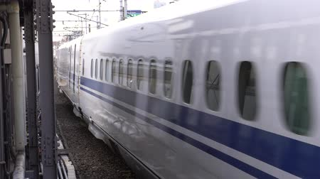 shinkansen : Aichi, Japan-May 11, 2018: a time lapse (double speed) shinkansen or a Japanese bullet train arriving at Nagoya station