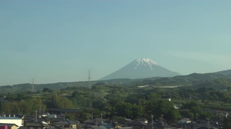 shinkansen : Shizuoa, Japan-May 11, 2018: View of Mt. Fuji from a bullet train, which runs in Fuji city in the morning. Stock Footage