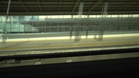 shinkansen : Aichi, Japan-May 14, 2018: shinkansen or a Japanese bullet train, Hikari, passes Toyohashi station at around 7: 05 AM Stock Footage