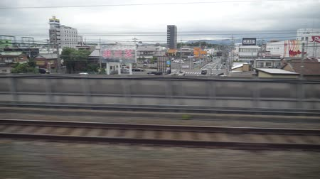 shinkansen : Shizuoka, Japan-May 20, 2018: shinkansen or a Japanese bullet train, Hikari, passes Kakegawa station at around 6: 51 AM