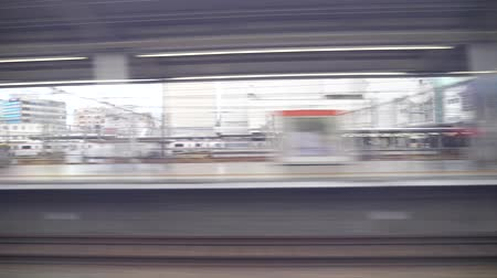 kurşun : Aichi, Japan-May 20, 2018: shinkansen or a Japanese bullet train, Hikari, passes Toyohashi station at around 7: 05 AM
