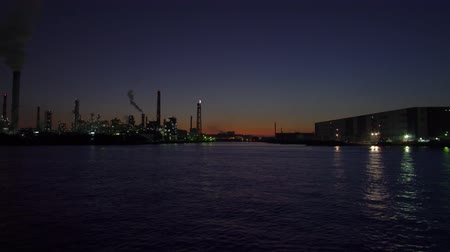 Kanagawa,Japan-December 1, 2019: Flare Stack Observed from Canal in Tokyo at Night. Stock mozgókép