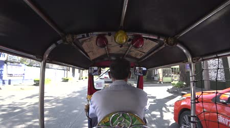 rickshaw : Bangkok,Thailand-January 27, 2020: Passenger view on a tuktuk seat running on Surawong Road in Bangkok, Thailand