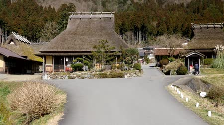 Kyoto,Japan-February 24, 2020: Miyamas ThatChed Village (Kayabuki no Sato) in, Kyoto Stock mozgókép