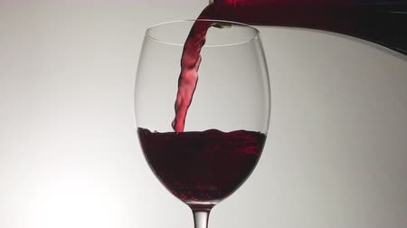 burgundské : Red Wine Pouring into Glass from a Bottle