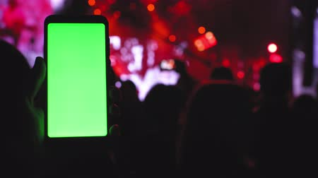 Smartphone greenscreen, party concert concept, chill rave dancing stage on music open air rock festival 4k Vídeos