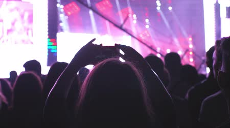 People on concert holding smart phones and shooting photographing, technology, young life concept Vídeos