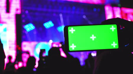 Smartphone green screen closeup concert party background technology innovation concept