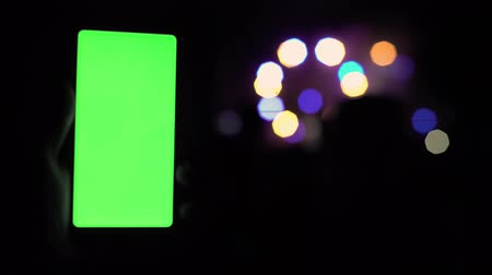 félrebeszél : Green screen smartphone blur blurred background light lantern stroboscope reflections glow bokeh light night concert party 4k technology