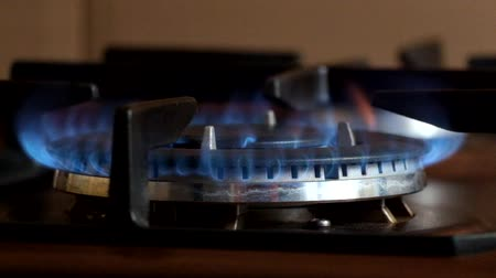 Gas burner burns with a blue flame and slowly extinguishes
