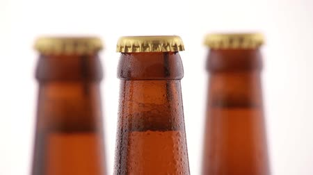 clipping path : Bottle of beer with drops isolated on white background. Focus to