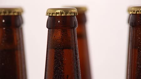 clipping path : Bottle of beer with drops isolated on white background. Rotation. Stock Footage