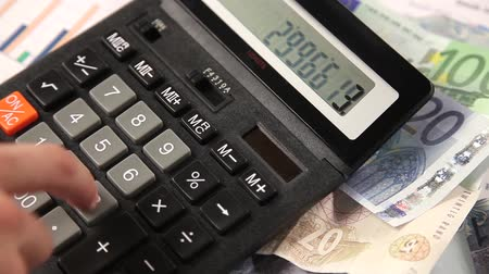 директор : Business man working with calculator in the office. Account on a calculator.
