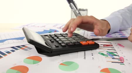 ksiegowosc : Business man working with calculator in the office. Account on a calculator.