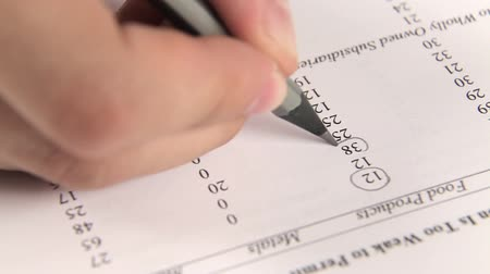 ручки : Work with financial report on table, pen.