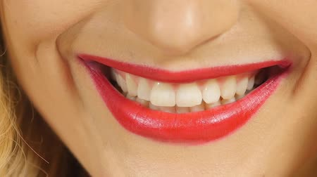 закрывать : Beautiful smile of pretty girl with red lips, close up, slow motion