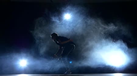 рэп : Young hiphop, b-boy dancer making a movements, smoke, silhouette, slow motion Стоковые видеозаписи