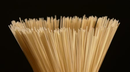 gourmet : The top of long type of pasta, on black background, rotation, close up