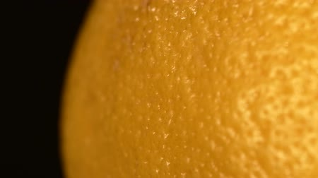 ferahlatıcı : One side of ripe orange isolated on black background, rotation, close up