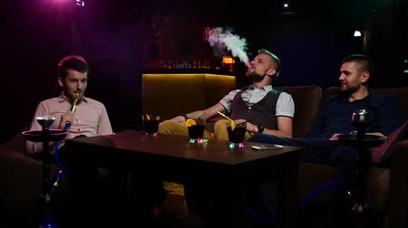 lounge : Group of young and sexy people smoking hookah in the lounge caffee. Slow motion