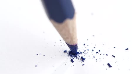 ołówek : Broken head of sharp blue pencil on a white paper, slow motion