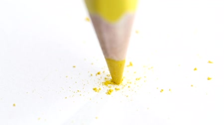 flunk : Broken head of sharp yellow pencil on a white paper, slow motion Stock Footage
