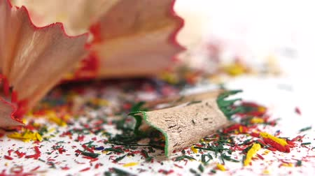 sharpened : Different crayon shavings on white background, close up, slow motion Stock Footage