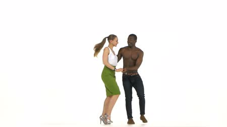 tutku : Social latino dancers european girl and afro american man in action isolated on white background