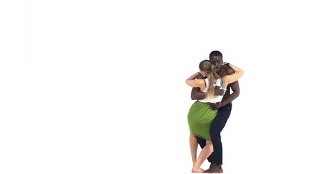 tutku : Attractive social latino dancers european girl and afro american man go on dancing isolated on white background, slow motion