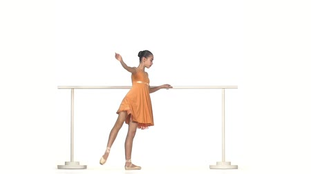 bale : Very Young Ballerina Posing in dress on White Background. slow motion Stok Video