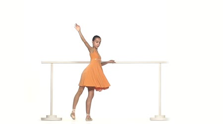 esneme : Very Young Ballerina Posing in dress on White Background. slow motion Stok Video