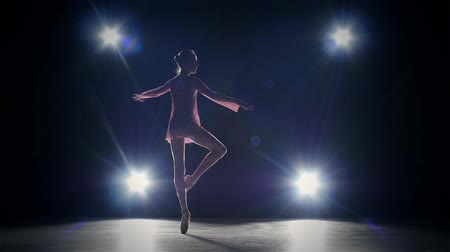 beautiful woman ballet dancer isolated on black background. silhouette. slow motion