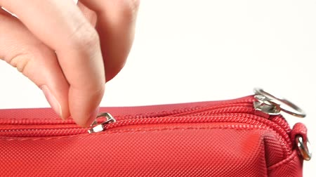 stuff bag : Unbutton red little handbag, on white background, slow motion Stock Footage