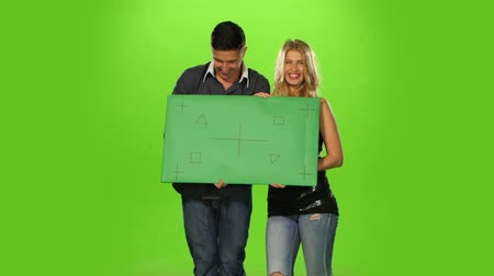 держит : Couple holding up a blank sign, People holding a blank paper. On green screen