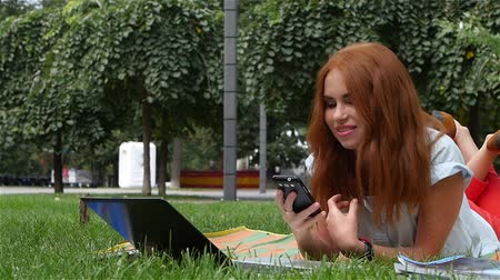 notebooklar : Beautiful young woman with a laptop  Outside School Campus,  slow motion