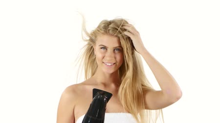 kurutma : woman in bathroom drying hair with blow dryer, lovely woman in towel. white background, bathroom Stok Video