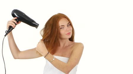 сушка : Redhead woman in bathroom drying hair with blow dryer, lovely woman in towel. white background, Black hair dryer, bathroom Стоковые видеозаписи