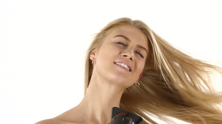 сушка : woman in bathroom drying hair with blow dryer, lovely woman in towel. white background. Close up. slow motion, bathroom