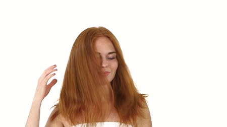 tüyler : Beautiful woman with long straight hair. Fashion model posing at studio. Hair Care. Spa Beauty Model. white background. slow motion. Close up, bathroom Stok Video