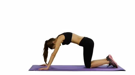 fit : Young fit woman doing yoga exercises on yoga mat at gym, white background, stretching