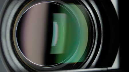 camera operator : Video camera lens, showing zoom, close up Stock Footage