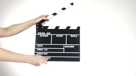 film slate : Hands use movie production clapper board, on white, slow motion