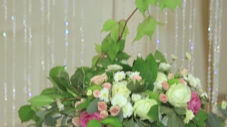 escarlate : Bouquets with fresh flowers hanging as decoration for holidays
