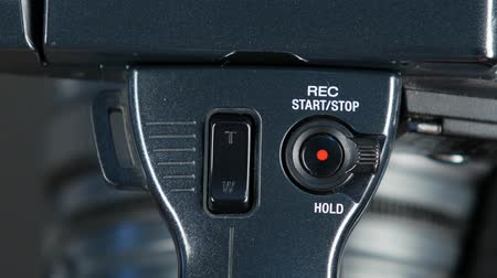 labeled : Hand presses record button, close up, front view