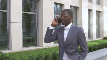 business man : American business man making a mobile  phone call - Black people
