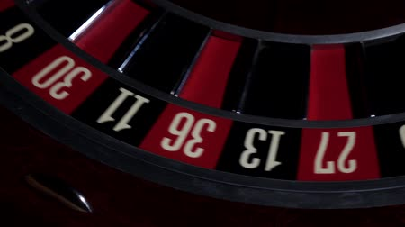 usual : Usual roulette wheel running with white ball, top view