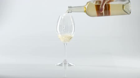 şişeler : White wine poured into glass, white