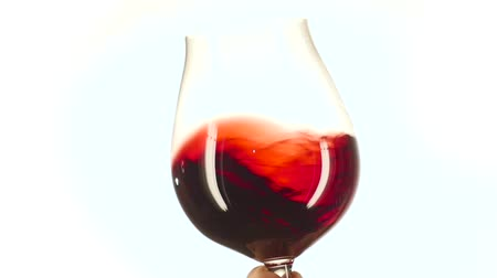 beyaz şarap : Isolated and moving red wine glass, white, slowmotion, closeup