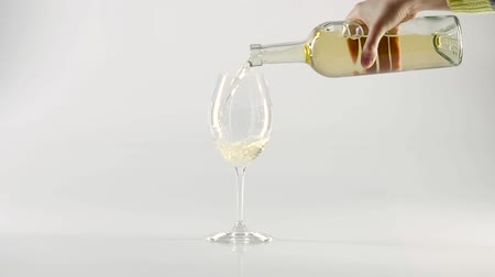 beyaz şarap : Pouring sparkling white wine into a wineglass with bottle, white, slowmotion